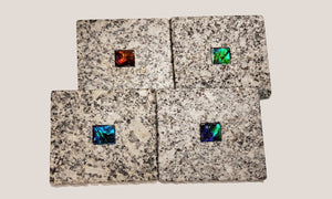 Set of Four Coasters in Granite with Ammolite Gemstones