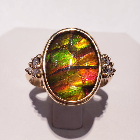 Ammolite 10x16mm Oval Ring with Six Accent Diamonds Set in Gold.