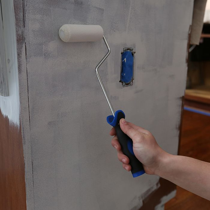 Prime kitchen cabinets using a paint roller