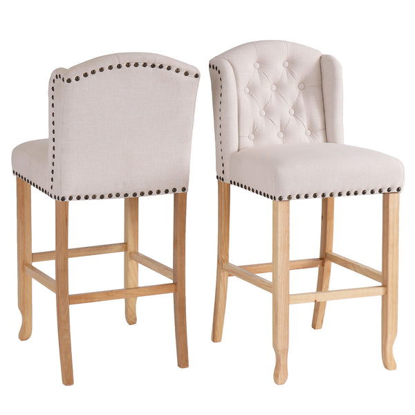 Front and back view image of a beige fabric bar stool with studded detail and oak legs