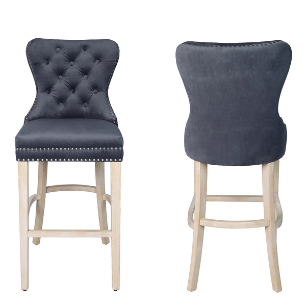 Front and back view image of a grey fabric bar stool with studded detail and oak legs