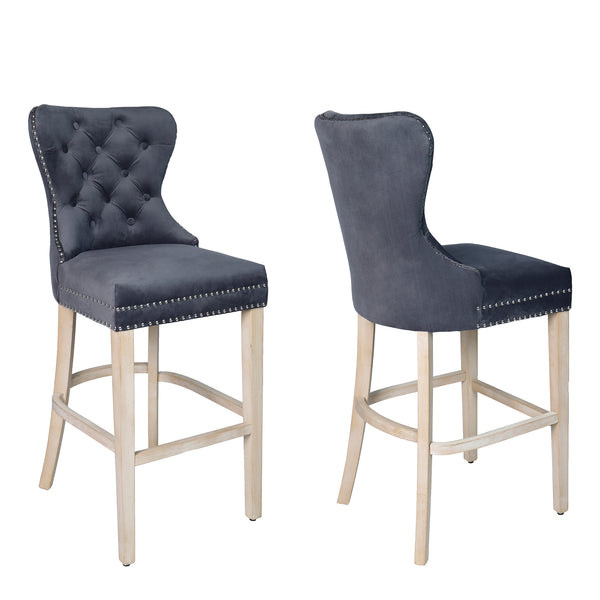 Front and side view image of a grey fabric bar stool with studded detail and oak legs