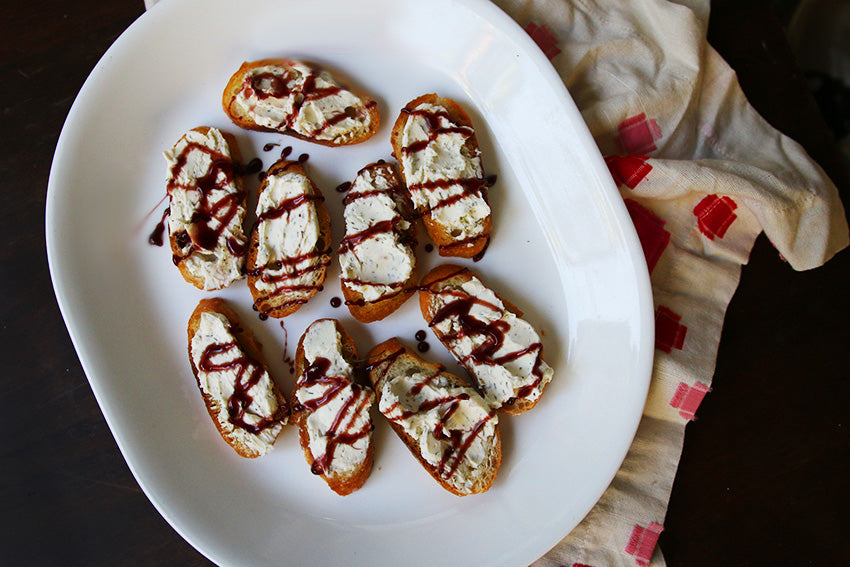 Crostini with Spiced Cream Cheese and Cranberry Balsamic Glaze