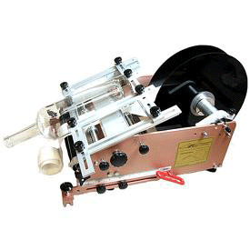 Taper Capable Bottle Labeler With Spring Plate