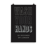 "This is an art print featuring a black background with white and light grey all caps type that says, ""Wash your hands, 20 seconds or longer."""