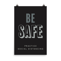 "This is an art print featuring a black background with white and light grey type that says, ""Be safe, practice social distancing."""