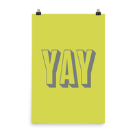 "This is an art print featuring a yellow background with gray all caps type that says, ""Yay."""
