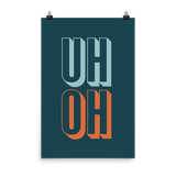 "This is an art print featuring a navy background with marine blue and orange all caps type that says, ""Uh oh."""