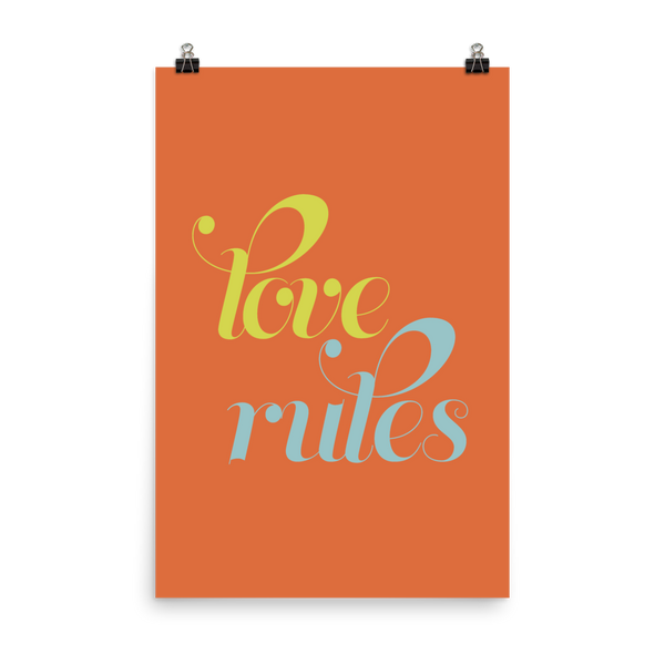 "This is an art print featuring an orange background with marine blue and bright yellow lowercase type that says, ""Love rules."""