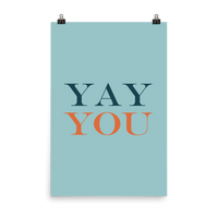 "This is an art print featuring a marine blue background with navy and orange all caps type that says, ""Yay you."""