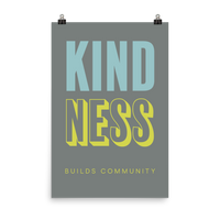 "This is an art print featuring a grey background with marine blue and bright yellow all caps type that says, ""Kindness builds community."""