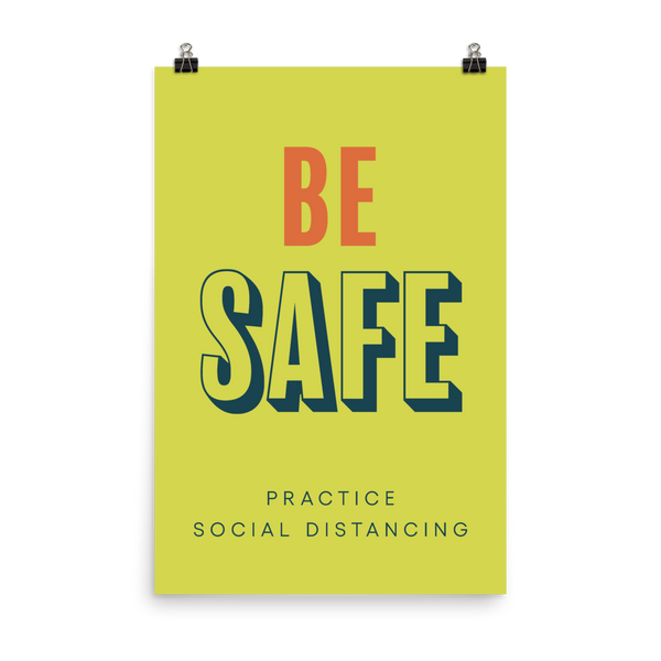"This is an art print featuring a bright yellow background with orange and blue type that says, ""Be safe, practice social distancing."""