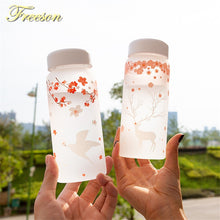 Load image into Gallery viewer, Sakura Swallow Frost Glass Water Bottle with Sleeve 430ml Elk Bottles Creative Camping Sport Bottle Tour Drinkware Dropshipping