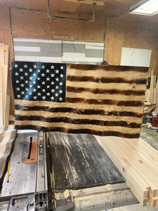 Small charred wavy American Flag