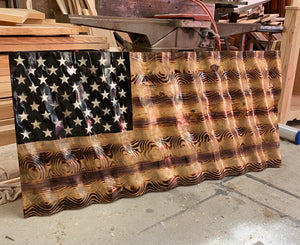 Large charred wavy American Flag