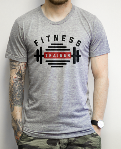 Fitnes Trainer on an Athletic Grey Tee Shirt