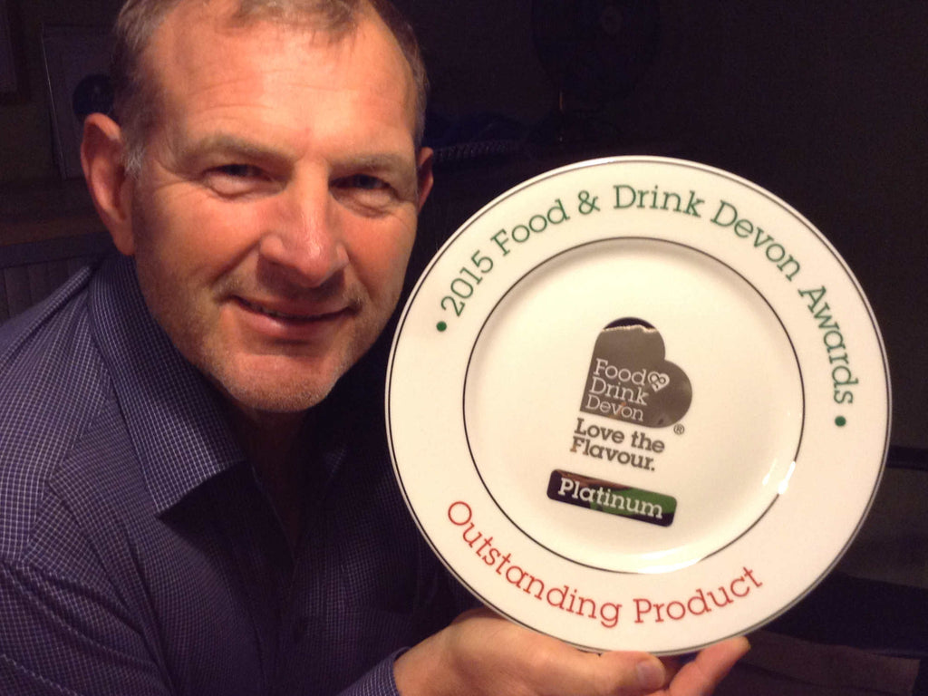 Simon (MD & Co Founder of Chunk of Devon) with Platinum Award.