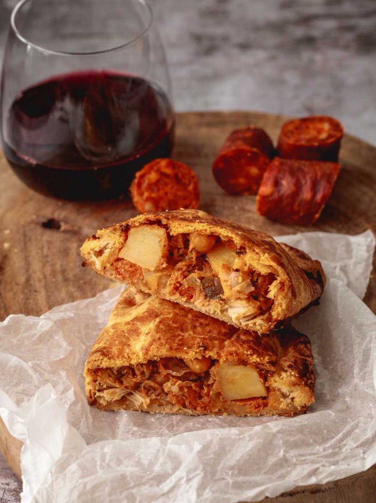 chicken and chorizo pasty hand made by Chunk of Devon with a glass of red wine