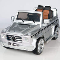 silver toddler mercedes g55 with leather seat remote and rubber tires