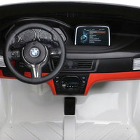 BMW X6 M with remote control ride on interior