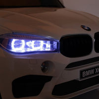 Toddler two seat BMW X6 M headlights
