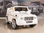 white mercedes g55 with leather seat remote and rubber tires