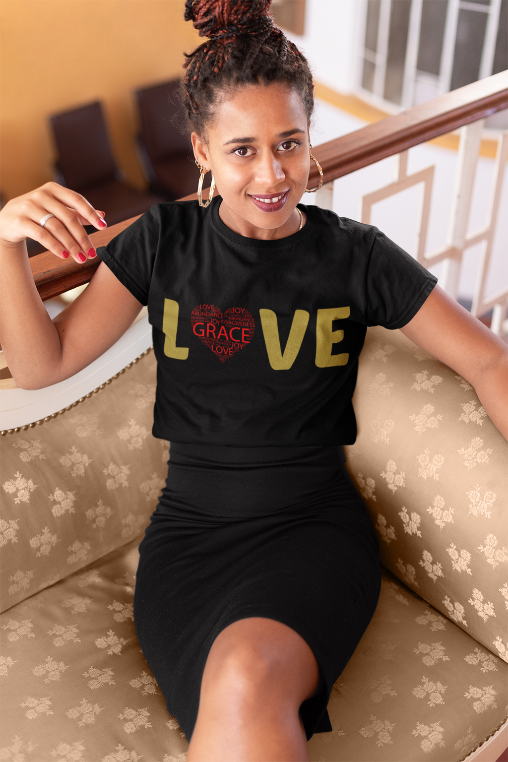 woman sitting on vintage sofa with a crop tee with thw word Love written on it