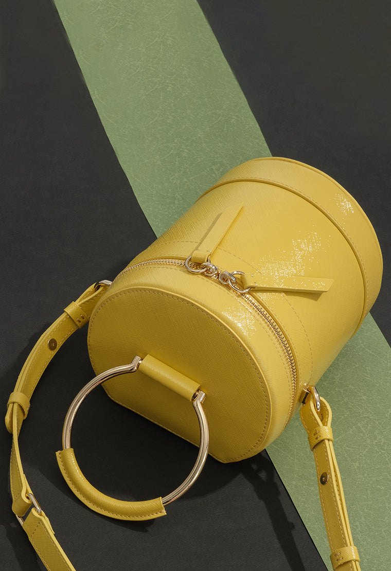 Trendy cylindrical leather handbag