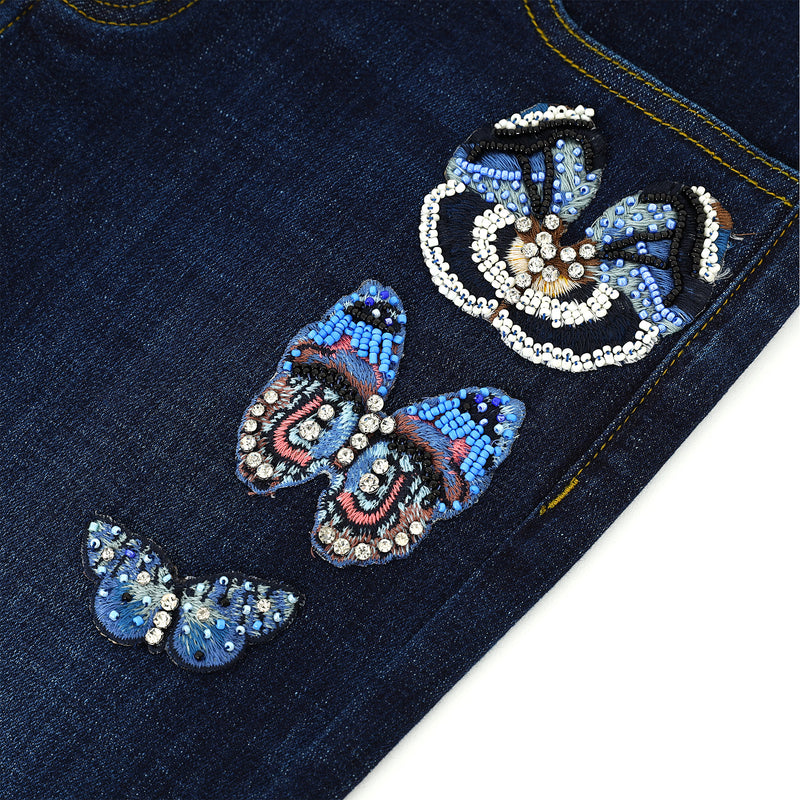Butterfly & crystal-embellished jeans