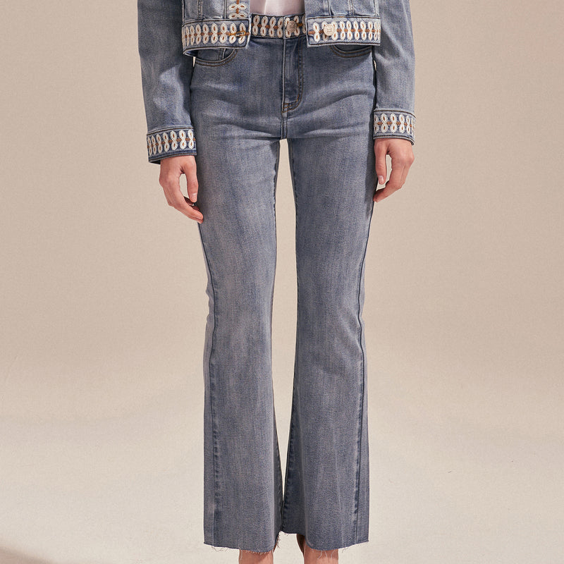 Lace-embroidered straight-leg jeans