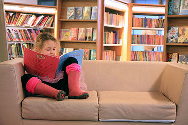 image:Girl reading a book.