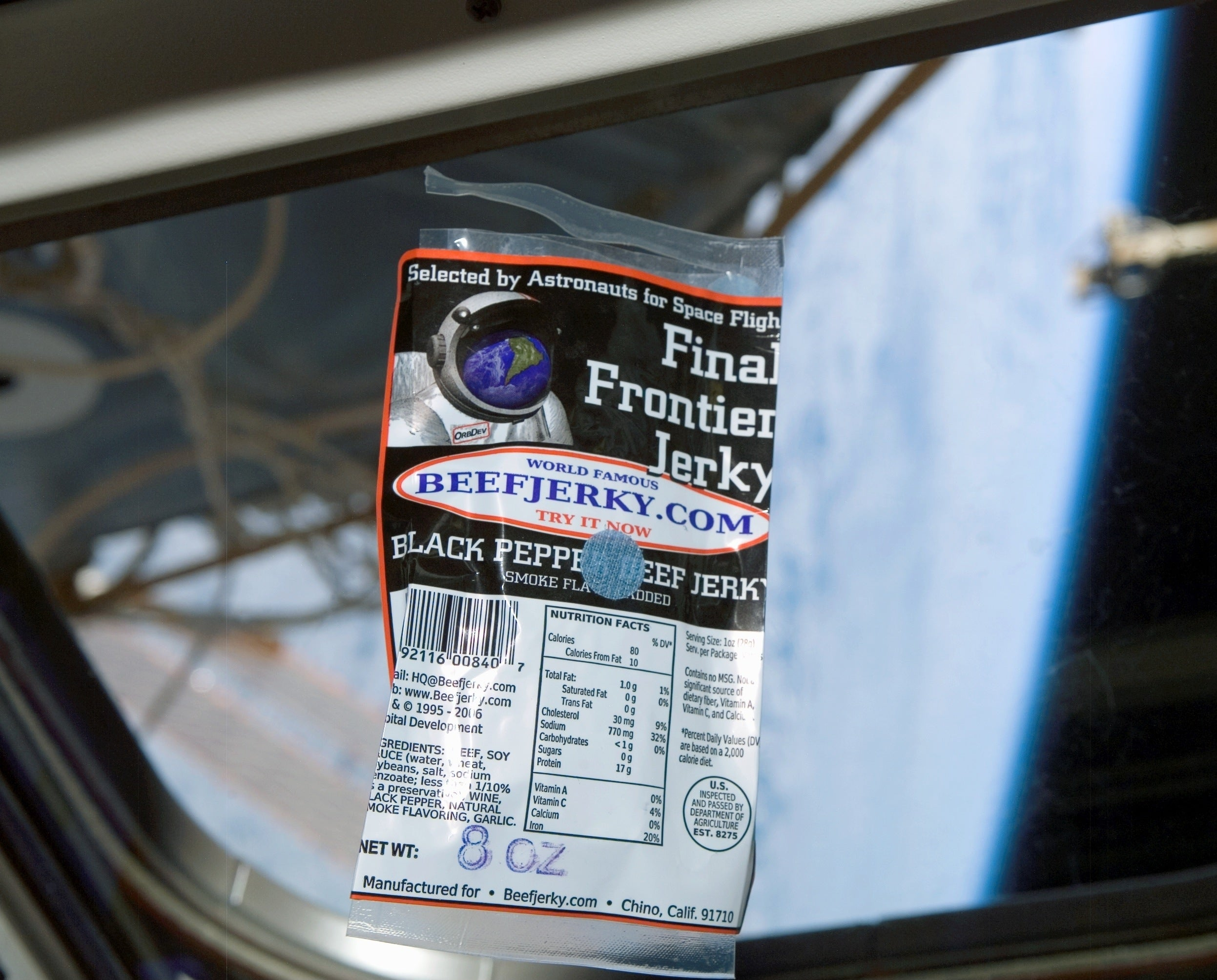 Beef Jerky on International Space Station with Earth visible out the big window. Carried to ISS aboard STS-118, Endevour Space Shuttle flight.