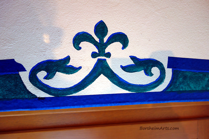 In one bedroom, the color choice was a teal with blue highlights for the window mural design.