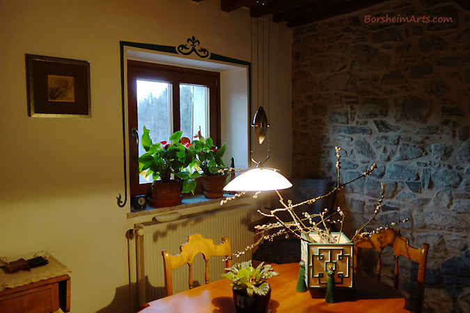One of the rooms in a Tuscan home in which I painted a simple colorful design over the top and sides of the windows. This room received green.