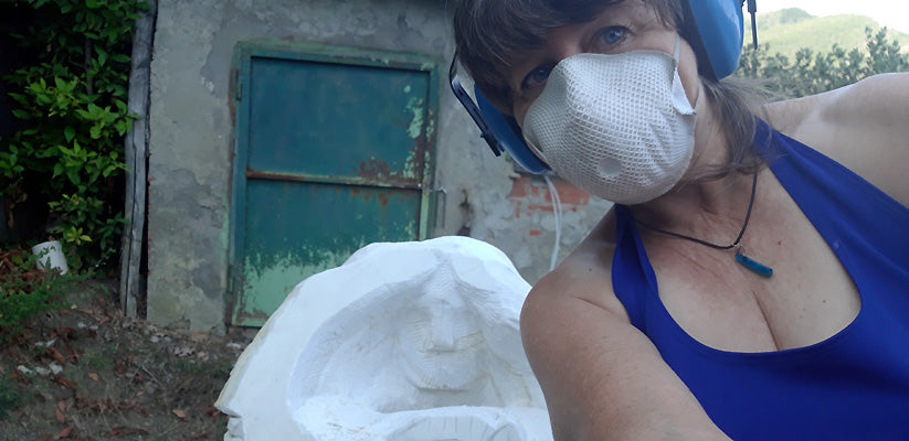 Artist selfie after my neighbor helped me move my stone from the car to my little work area below a dirt road.