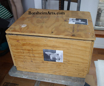 Wooden crate built specifically for each individual sculpture here Fish Lips Canadian marble art