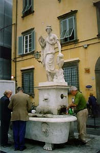 Statue of a Woman at a fountain in Lucca inspired the oil painting of Kelly Borsheim