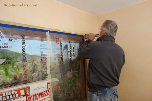 Wall Worker Antonio of Vellano added cement back into the wall to help with the faux window Mural