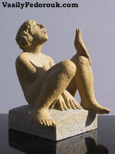 Ceramic Sculpture of young man looking up to sky bird on his knee also looking up