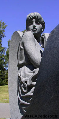"""Recording Angel"" (detail) granite tombstone by Vasily Fedorouk Seattle"