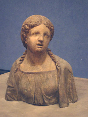 Ceramic antique sculpture portrait of a woman with sad eyes Bardini Museum Florence Italy