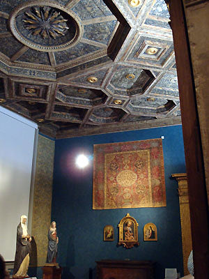 sculpted ceiling and blue walls contrast with traditional Tuscan yellow Bardini Museum Florence Italy