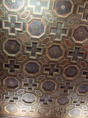 painted wood ceiling design of alternating crosses and octagons Bardini Museum Florence Italy