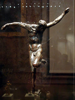 Bronze Crucifix with wavy arms Bardini Museum Florence Italy
