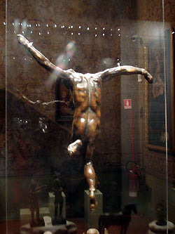back view of bronze crucifix mounted on clear plastic for total display Bardini Museum Florence Italy