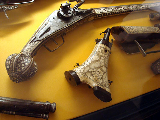 carved gun handle in weapons room exhibit Bardini Museum Florence Italy