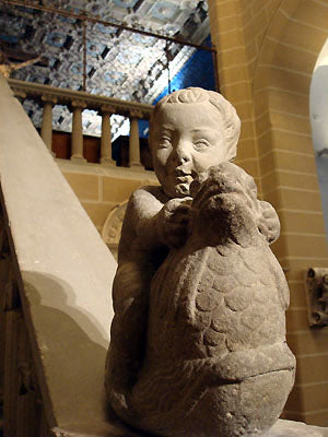 Baby in stone statue at the base of staircase hand rail Bardini Museum Florence Italy