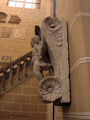 winged cherub standing on scroll design architectural feature Stefano Bardini Museum in Florence, Italy