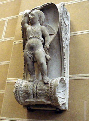 winged cherub standing on scroll design architectural decoration Stefano Bardini Museum in Florence, Italy