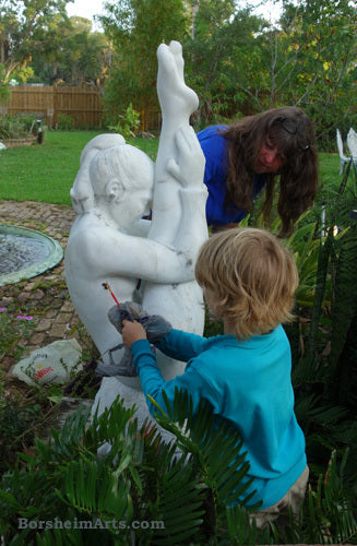 In Sanford, Florida, my nephew August helped me clean the Gymnast before adding more stone sealer to protect the marble.